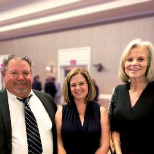 Heidi visits with Scott and Dana Richardson. Dana represents the Edison School of Innovation in Glendale, AZ.